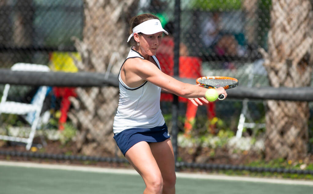 Elly Shearman playing tennis.
